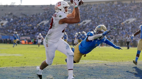 <p>               FILE - In this Nov. 24, 2018, file photo, Stanford wide receiver JJ Arcega-Whiteside, left, catches a touchdown pass next to UCLA defensive back Darnay Holmes during the second half of an NCAA college football game in Pasadena, Calif. Stanford's best offense has been having K.J. Costello throw the ball up to Arcega-Whiteside and let the physical receiver come down with the catch or draw a penalty. Arcega-Whiteside has caught 14 TD passes, tying the school record set by Pro Football Hall of Famer James Lofton in 1977. (AP Photo/Marcio Jose Sanchez, File)             </p>