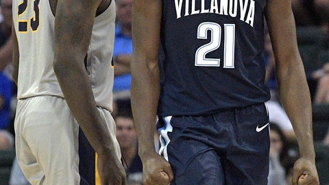 <p>               Villanova forward Dhamir Cosby-Roundtree (21) reacts after a play in front of Canisius forward Dantai St. Louis (23) during the second half of an NCAA college basketball game Thursday, Nov. 22, 2018, in Kissimmee, Fla. (AP Photo/Phelan M. Ebenhack)             </p>