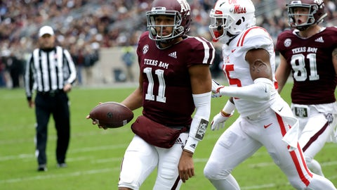 <p>               Texas A&M quarterback Kellen Mond (11) rushes for a touchdown as Mississippi Rebels defensive back Myles Hartsfield (15) defends during the first half of an NCAA college football game Saturday, Nov. 10, 2018, in College Station, Texas. (AP Photo/David J. Phillip)             </p>