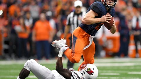 <p>               Syracuse quarterback Eric Dungey, top, tries to break the grasp of Louisville defensive end Tabarius Peterson during the first half of an NCAA college football game in Syracuse, N.Y., Friday, Nov. 9, 2018. (AP Photo/Adrian Kraus)             </p>