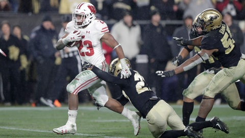 <p>               Wisconsin running back Jonathan Taylor (23) breaks the tackle of Purdue safety Navon Mosley (27) on his way to scoring a game-winning touchdown during overtime of an NCAA college football game in West Lafayette, Ind., Saturday, Nov. 17, 2018. Wisconsin defeated Purdue 47-44 in overtime. (AP Photo/Michael Conroy)             </p>