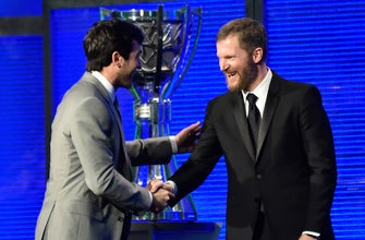 Dale Earnhardt Jr. presents Chase Elliott with the NASCAR Cup Series Most Popular Driver award