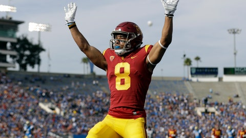 <p>               Southern California wide receiver Amon-Ra St. Brown (8) raises his arms after a touchdown reception against UCLA during the first half of an NCAA college football game Saturday, Nov. 17, 2018, in Pasadena, Calif. (AP Photo/Marcio Jose Sanchez)             </p>