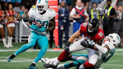 <p>               FILE - In this  Sunday, Oct. 15, 2017 file photo, Miami Dolphins free safety Reshad Jones (20) picks up the ball against Atlanta Falcons tight end Austin Hooper (81) during the second half of an NFL football game in Atlanta. Miami Dolphins safety Reshad Jones talks about taking himself out of the team's most recent games, and his relationship with embattled defensive coordinator Matt Burke. Coach Adam Gase has said Jones will play Sunday, Nov. 11, 2018 against Green Bay. (AP Photo/David Goldman, File)             </p>