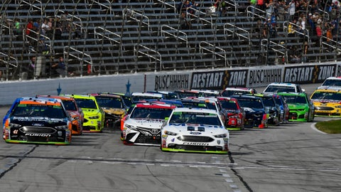 <p>               Kurt Busch (41) and Kevin Harvick (4) lead the pack down the front stretch on a restart during a NASCAR Cup auto race at Texas Motor Speedway, Sunday, Nov. 4, 2018, in Fort Worth, Texas. (AP Photo/Larry Papke)             </p>