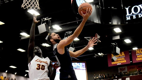 <p>               Nevada forward Caleb Martin (10) shoots against Loyola of Chicago forward Aher Uguak (30) during the first half of an NCAA college basketball game in Chicago, Tuesday, Nov. 27, 2018. (AP Photo/Matt Marton)             </p>