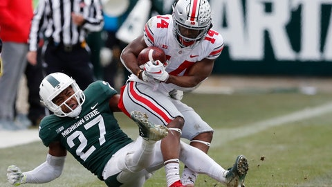 <p>               FILE - In this Nov. 10, 2018, file photo, Michigan State safety Khari Willis (27) stops Ohio State wide receiver K.J. Hill (14) during the second half of an NCAA college football game in East Lansing, Mich. In Willis' freshman season, the Spartans won the Big Ten and went to the College Football Playoff. Then the team collapsed to a 3-9 record the following year. Michigan State bounced back to win 10 games in 2017, but this season has been a disappointment the Spartans are barely bowl eligible as they enter their regular-season finale, against Rutgers. (AP Photo/Carlos Osorio, File)             </p>
