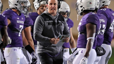 <p>               FILE - In this Saturday, Nov. 3, 2018, file photo, Northwestern coach Pat Fitzgerald talks with his players during the first half of an NCAA college football game against Notre Dame in Evanston, Ill. Northwestern can clinch the Big Ten West championship and its first appearance in the conference title game by winning two of its final three games.  (AP Photo/Jim Young)             </p>