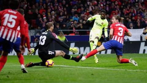 <p>               Barcelona's Ousmane Dembele, second right, scores his side's opening goal during a Spanish La Liga soccer match between Atletico Madrid and FC Barcelona at the Metropolitano stadium in Madrid, Saturday, Nov. 24, 2018. (AP Photo/Manu Fernandez)             </p>