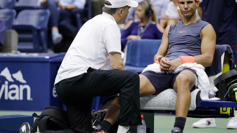 <p>               FILE- In this Sept. 7, 2018 file photo, Rafael Nadal, of Spain, is treated by a trainer during a change over against Juan Martin del Potro, of Argentina, during the semifinals of the U.S. Open tennis tournament, in New York. Nadal has pulled out of the season-ending ATP Finals because of an abdominal injury. Nadal announced Monday, Nov. 5 on Twitter that he is done for the year, citing the same stomach muscle issue that forced him to withdraw from last week's Paris Masters. He added that he also would have surgery on his right ankle so he can start 2019 healthy. Nadal hasn't competed since he retired from his U.S. Open semifinal because of a painful right knee.  (AP Photo/Seth Wenig, File)             </p>