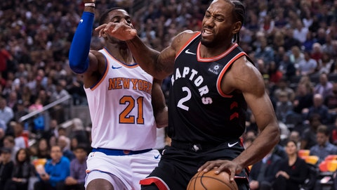 <p>               Toronto Raptors forward Kawhi Leonard (2) battles for the ball against New York Knicks guard Damyean Dotson (21) during first half NBA basketball action in Toronto on Saturday, Nov. 10, 2018. )Nathan Denette/The Canadian Press via AP)             </p>