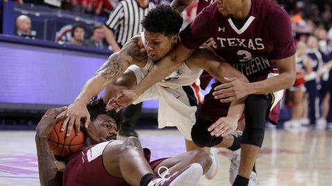 <p>               Texas Southern forward Jeremy Combs, left, guard Jalyn Patterson (3) and Gonzaga forward Brandon Clarke (15) go after the ball during the first half of an NCAA college basketball game in Spokane, Wash., Saturday, Nov. 10, 2018. (AP Photo/Young Kwak)             </p>