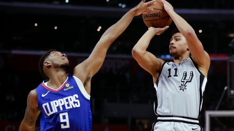 <p>               Los Angeles Clippers guard Tyrone Wallace blocks a shot by San Antonio Spurs guard Bryn Forbes during the first half of an NBA basketball game in Los Angeles, Thursday, Nov. 15, 2018. (AP Photo/Chris Carlson)             </p>