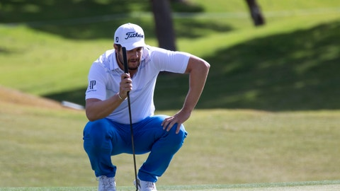 <p>               Peter Uihlein lines up his putt on the ninth green during the first round of the Shriners Hospitals for Children Open golf tournament at TPC at Summerlin in Las Vegas on Thursday, Nov. 1, 2018. (Richard Brian/Las Vegas Review-Journal via AP)             </p>