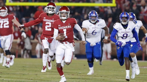 <p>               Oklahoma quarterback Kyler Murray (1) runs for a touchdown ahead of Kansas defenders during the second half of an NCAA college football game in Norman, Okla., Saturday, Nov. 17, 2018. Oklahoma won 55-40. (AP Photo/Alonzo Adams)             </p>