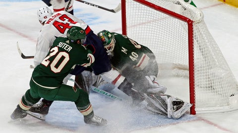 <p>               Washington Capitals' Tom Wilson, top left, scores a goal on Minnesota Wild goalie Devan Dubnyk, right, in the first period of an NHL hockey game Tuesday, Nov. 13, 2018, in St. Paul, Minn. Wilson returned to the lineup after his 20-game suspension was reduced to 14 by a neutral arbitrator. (AP Photo/Jim Mone)             </p>