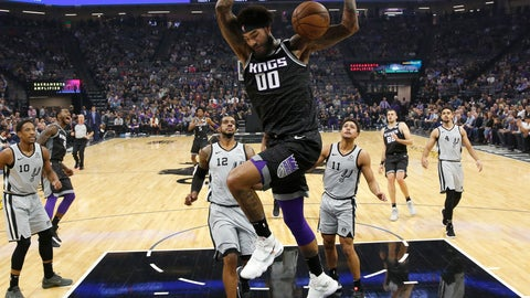 <p>               Sacramento Kings center Willie Cauley-Stein, center, stuffs as San Antonio Spurs' LaMarcus Aldridge (12) ands Bryn Forbes, (11) look on during the first quarter of an NBA basketball game Monday, Nov. 12, 2018, in Sacramento, Calif. (AP Photo/Rich Pedroncelli)             </p>