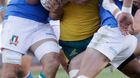 <p>               Australia's Scott Sio, center, is tackled by Italian players during the rugby union international match between Italy and Australia at the Euganeo Stadium in Padua, Italy, Saturday, Nov. 17, 2018. (AP Photo/Luca Bruno)             </p>