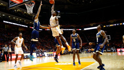 <p>               Tennessee guard Admiral Schofield (5) goes for a dunk over Georgia Tech forward James Banks III (1) during the second half of an NCAA college basketball game, Tuesday, Nov. 13, 2018, in Knoxville, Tenn. Tennessee won 66-53. (AP photo/Wade Payne)             </p>