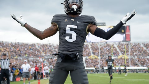 <p>               Central Florida wide receiver Dredrick Snelson (5) celebrates in the end zone after scoring a 34-yard receiving touchdown during the first half of an NCAA college football game against Navy, Saturday, Nov. 10, 2018, in Orlando, Fla. (AP Photo/Phelan M. Ebenhack)             </p>