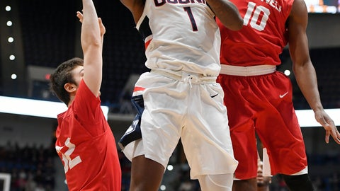 <p>               Connecticut's Christian Vital (1) shoots as Cornell's Jack Gordon (32) and Matt Morgan (10) defend during the first half of an NCAA college basketball game, Tuesday, Nov. 20, 2018, in Hartford, Conn. (AP Photo/Jessica Hill)             </p>
