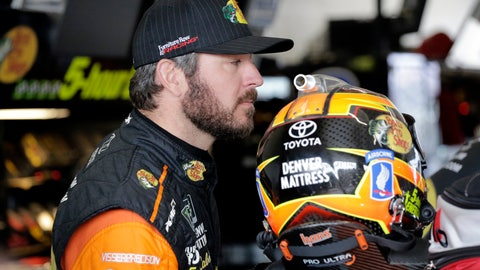 <p>               Martin Truex Jr. stands in the garage during practice for the NASCAR Cup auto race at the Homestead-Miami Speedway, Friday, Nov. 16, 2018, in Homestead, Fla. (AP Photo/Terry Renna)             </p>
