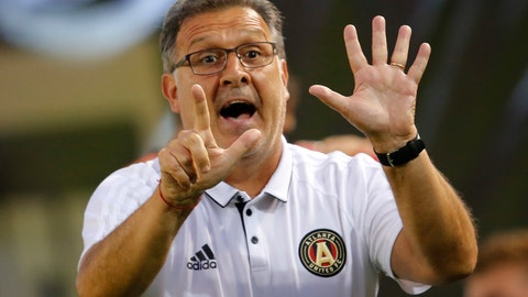 "<p>               FILE - In this June 17, 2017, file photo, Atlanta United head coach Gerardo ""Tata"" Martino signals to his players in the second half of an MLS soccer match against the Columbus Crew in Atlanta. The New York Red Bulls and Atlanta United are clearly the two best teams in Major League Soccer These two powerhouses will meet in a two-leg Eastern Conference final, which begins Sunday night before another expected crowd of more than 70,000 at Mercedes-Benz Stadium. The second game will be held Thursday night in Harrison, N.J. (AP Photo/John Bazemore, File)             </p>"