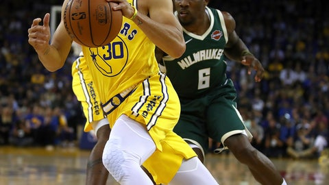 <p>               Golden State Warriors' Stephen Curry drives the ball past Milwaukee Bucks' Eric Bledsoe (6) during the first half of an NBA basketball game Thursday, Nov. 8, 2018, in Oakland, Calif. (AP Photo/Ben Margot)             </p>