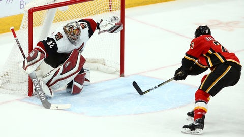 <p>               Arizona Coyotes goaltender Antti Raanta (32) gives up a short-handed goal to Calgary Flames Noah Hanifin during the first period of an NHL hockey game Sunday, Nov. 25, 2018, in Glendale, Ariz. (AP Photo/Ross D. Franklin)             </p>