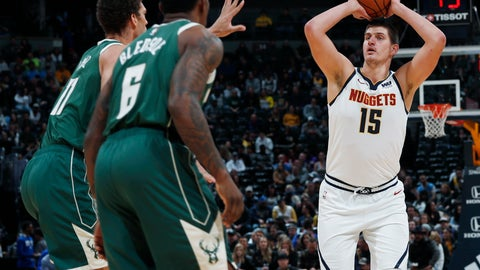 <p>               Denver Nuggets center Nikola Jokic, right, shoots for the rim over Milwaukee Bucks guard Eric Bledsoe, front left, and center Brook Lopez in the first half of an NBA basketball game Sunday, Nov. 11, 2018, in Denver. (AP Photo/David Zalubowski)             </p>
