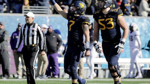<p>               West Virginia quarterback Will Grier (7) and offensive lineman Colton McKivitz (53) celebrate a touchdown during the first half of an NCAA college football game against TCU, Saturday, Nov. 10, 2018, in Morgantown, W.Va. (AP Photo/Raymond Thompson)             </p>