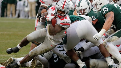 <p>               Ohio State running back Mike Weber (25) falls into the end zone for a 2-yard rushing touchdown during the second half of an NCAA college football game against the Michigan State, Saturday, Nov. 10, 2018, in East Lansing, Mich. (AP Photo/Carlos Osorio)             </p>