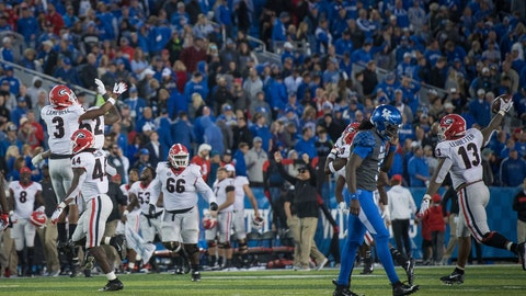 <p>               Georgia players celebrate victory after defeating Kentucky in an NCAA college football game in Lexington, Ky., Saturday, Nov. 3, 2018. (AP Photo/Bryan Woolston)             </p>