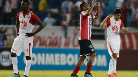 <p>               Luis Narvaez of Colombia's Junior, center, celebrates at the end of a Copa Sudamericana second leg semifinal match against Colombia's Independent Santa Fe at the Metropolitano stadium in Barranquilla, Colombia, Thursday, Nov., 29, 2018. Junior won 3-0 on aggregated and and qualified for the final. (AP Photo/Fernando Vergara)             </p>