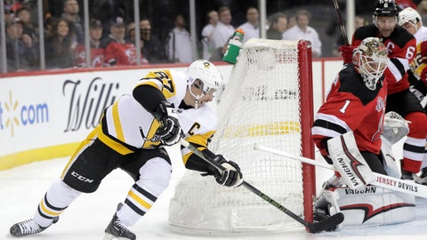 <p>               Pittsburgh Penguins center Sidney Crosby (87) attacks on New Jersey Devils goaltender Keith Kinkaid (1) during the first period of an NHL hockey game, Tuesday, Nov. 13, 2018, in Newark, N.J. (AP Photo/Julio Cortez)             </p>