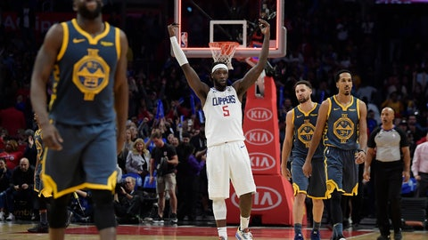 <p>               Los Angeles Clippers forward Montrezl Harrell, center, celebrates as time runs out in overtime as Golden State Warriors forward Draymond Green, left, guard Klay Thompson, second from right, and guard Shaun Livingston walk off the court in an NBA basketball game, Monday, Nov. 12, 2018, in Los Angeles. The Clippers won 121-116 in overtime. (AP Photo/Mark J. Terrill)             </p>
