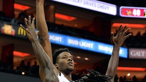 <p>               Louisville center Steven Enoch (23) shoots over Southern forward Bryan Assie (21) during the second half of an NCAA college basketball game, in Louisville, Ky., Tuesday, Nov. 13, 2018. Louisville won 104 - 54. (AP Photo/Timothy D. Easley)             </p>
