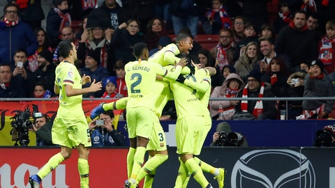 <p>               Barcelona players celebrate after Ousmane Dembele scored their first goal during a Spanish La Liga soccer match between Atletico Madrid and FC Barcelona at the Metropolitano stadium in Madrid, Saturday, Nov. 24, 2018. (AP Photo/Paul White)             </p>