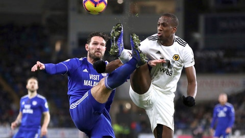 <p>               Cardiff City's Sean Morrison, left, and Wolverhampton Wanderers' Willy Boly battle for the ball during their Premier League soccer match at Cardiff City Stadium, Wales, Friday, Nov. 30, 2018. (Nick Potts/ PA via AP)             </p>