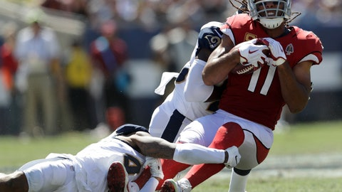 <p>               File-This Sept. 16, 2018, file photo shows Arizona Cardinals wide receiver Larry Fitzgerald, right, being tackled during the first half of an NFL football game in Los Angeles. Fitzgerald (1,276 career receptions) needs six catches to pass Jerry Rice for most receptions in NFL history with one team. (AP Photo/Marcio Jose Sanchez, File)             </p>