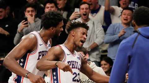 <p>               Philadelphia 76ers' Joel Embiid, left, congratulates teammate Jimmy Butler (23) after he sank a game-winning three point shot against the Brooklyn Nets in the fourth quarter of an NBA basketball game, Sunday, Nov. 25, 2018, in New York. The 76ers won 127-125. (AP Photo/Mark Lennihan)             </p>