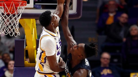 <p>               LSU forward Kavell Bigby-Williams (11) blocks a shot by UNC Greensboro forward James Dickey (21) in the first half an NCAA college basketball game in Baton Rouge, La., Friday, Nov. 9, 2018. (AP Photo/Gerald Herbert)             </p>
