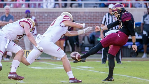 <p>               Boston College's Hunter Long blocks a punt but commits a roughing the kicker penalty against Florida State punter Logan Tyler in the first quarter of an NCAA college football game in Tallahassee, Fla., Saturday, Nov. 17, 2018. (AP Photo/Mark Wallheiser)             </p>