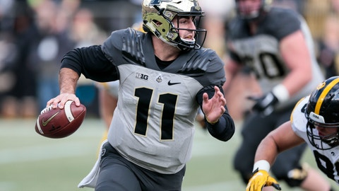 <p>               FILE - In this Saturday, Nov. 3, 2018, file photo, Purdue quarterback David Blough (11) runs with the ball in the first half of an NCAA college football game  against Iowa in West Lafayette, Ind. Purdue needs one more win to become bowl eligible, but the Boilermakers are chasing more than that, still with an outside chance at winning the Big Ten West Division, where Minnesota sits at the bottom thanks to a reeling defense. (AP Photo/AJ Mast, File)             </p>