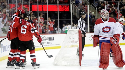 <p>               New Jersey Devils, left, celebrate a goal by center Pavel Zacha (37) as Montreal Canadiens goaltender Carey Price, right, skates away during the second period of an NHL hockey game Wednesday, Nov. 21, 2018, in Newark, N.J. (AP Photo/Julio Cortez)             </p>