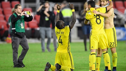 <p>               Columbus Crew SC defender Jonathan Mensah (4), midfielder Artur (8) and defender Gaston Sauro (22) celebrate after winning an MLS playoff soccer match in penalty kicks against D.C. United, Thursday, Nov. 1, 2018, in Washington. The Crew SC won 2-2 (3-2) in penalty kicks. (AP Photo/Nick Wass)             </p>