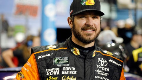 <p>               Martin Truex Jr. stands next to his car during qualifying for the NASCAR Cup Series auto race at the Homestead-Miami Speedway, Friday, Nov. 16, 2018, in Homestead, Fla. (AP Photo/Terry Renna)             </p>