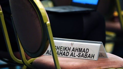 <p>               A name plate of Sheikh Ahmad al Fahad al Sabah, temporary ousted president of Association of National Olympic Committees (ANOC) is placed on a chair during the ANOC general assembly in Tokyo Thursday, Nov. 29, 2018. (AP Photo/Eugene Hoshiko)             </p>