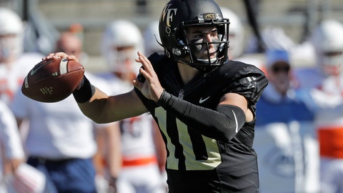 <p>               Wake Forest's Sam Hartman (10) looks to pass against Syracuse in the first half of an NCAA college football game in Charlotte, N.C., Saturday, Nov. 3, 2018. (AP Photo/Chuck Burton)             </p>