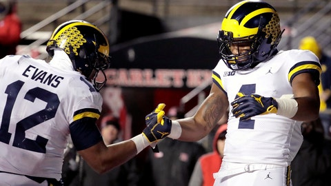 <p>               Michigan wide receiver Nico Collins, right, celebrates his touchdown catch with running back Chris Evans during the second half of an NCAA college football game against Rutgers, Saturday, Nov. 10, 2018, in Piscataway, N.J. (AP Photo/Julio Cortez)             </p>